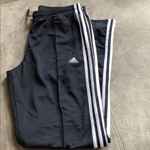 Black adidas pants with side stripes